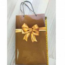 Пакет подарочный с бантом золото средний вертикальный